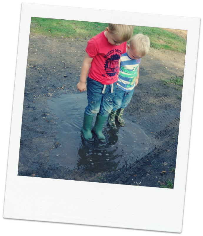 Boys in a puddle